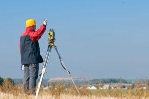 Land Surveyor In Field