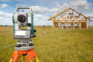 Land surveying equipment in front of a home being built